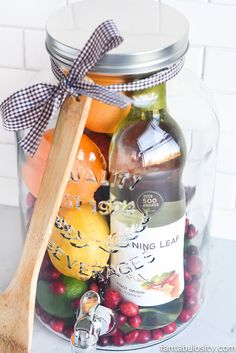 Aw, how cool is this! DIY Gift Idea: Sangria for Friends, housewarming, for women, new neighbor, anyone! Who wouldn't love this!? They can even use the drink dispenser again and again!