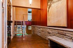 warm on white. plus materials.  natural stacked stone wall, grasscloth wallpaper, warm wood paneling, clay tile