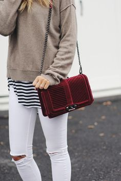 taupe sweater + black and white stripe top + white distressed skinny jeans + maroon velvet purse