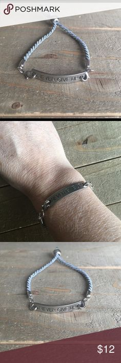 """""""Never Give Up"""" Inspirational Adjustable Bracelet I made this beautiful adjustable bracelet with a gray rope style bracelet and a silver inspirational connector """"Never Give Up"""" Handmade Jewelry Bracelets"""