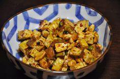Slice of Rice: Pressed Tofu and Peanuts in Spicy Bean Sauce (Hua Ren Dou Fu Gan)