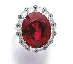 Ruby and diamond ring, Harry Winston. Set with an oval ruby weighing 20.42 carats, within a frame of brilliant-cut diamonds.