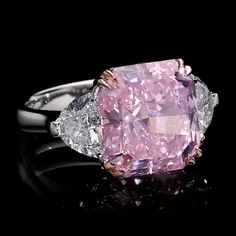 Dehres. Extraordinary and breathtaking 10 carats Radiant Cut Fancy Intense Purplish Pink is a true masterpiece.