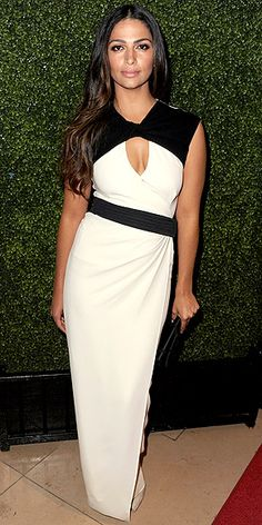 CAMILA MCCONAUGHEY working black and white.  I love the asymmetrical belt and the black top shoulder cover.