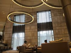 lobby lighting   The Lounge lobby bar at the Nikko Saigon Hotel with sofas and chairs ...