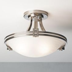 Sharp, stylish brushed nickel semi-flushmount ceiling light from the Deco Nickel Collection.