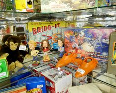 Dukes of Hazzard bobble heads, Transformers collectors case, Star Wars vehicle and other various toys in the showcase area.