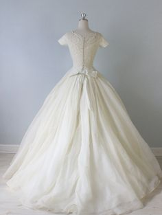 Vintage 1950s Ballgown Wedding Dress from The Vintage Mistress / I hate to be a party pooper but that waist looks unnaturally small and no one's legs are that long in comparison to the torso / Is this perhaps a sample used for show, not ever worn maybe?