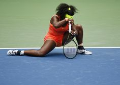 Serena Williams of the U.S. gets up slowly from the court in the third set against Roberta Vinci of Italy during their women's singles semi-final match at the U.S. Open Championships tennis tournament in New York, September 11, 2015. REUTERS/Lucas Jackson