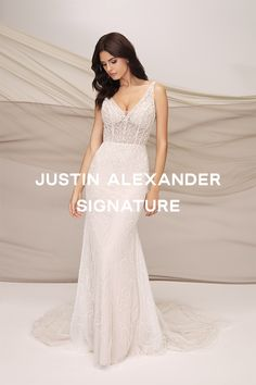 Fall in love with this opulent allover beaded fit and flare gown. With a flattering V-Neck and V-Back, illusion bodice, and body-sculpting Power Mesh lining. Accented with Sparkle tulle underneath the floral motif beading that extends to the bottom of the skirt and train. You will have the wedding pictures of your dreams in this stunning piece. Also available in a lined version. #Justinalexandersignature #Jasbride #justinalexander Justin Alexander Bridal, Wedding Gowns, Our Wedding, Body Sculpting, Floral Motif, Wedding Pictures, Fit And Flare, Illusion, Ruffles