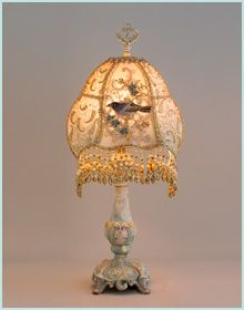 Antique shabby chic table lamp holds a hand-dyed Petit Oiseau (Little Bird) silk lampshade.