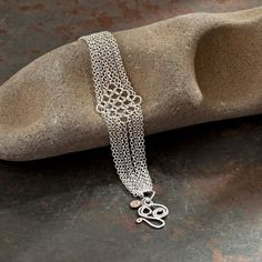 """You could help decide the October cover of The Crafts Report magazine. Just go to www.facebook.com/CraftsReport and click """"Like"""" at the bottom of WorldWise Jewelry's Flowing Silver Bracelet. The photo was shot by the incredibly talented photographer, Rick Dahms."""