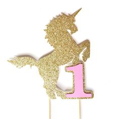 This gold glitter unicorn birthday cake toppers makes a whimsical addition to any unicorn party, birthday party, 1st birthday party, princess