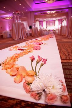 elaborate flower petal layout on the wedding reception aisle | Gorgeous Muslim Wedding by Carrie Wildes