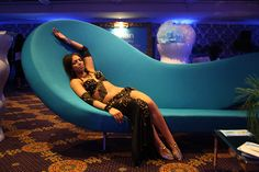 Mylan's stand for 'The Imaginarium of Dr. Mylan' conference. Reclining belly dancer.