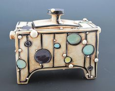 Carol Long Pottery. Lidded Box::$325 H 6.5in L 8in W 4in