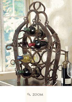 Horseshoe wine rack!!!!  Cute touch to a rustic cowboyish decor