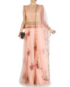 05b8d10c1be Featuring a Pretty Peach Sleeveless Top   Skirt Set adorned with heavy  embroidery on the top and skirt using dabka