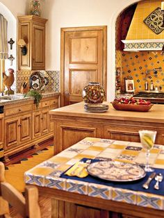 Beautiful Mexican tiles are used in several rooms of this home, making the strongest statement in the kitchen. The yellow-and-blue tiles mix with pine cabinetry. (Photo: Photo: Laurey W. Glenn; Stylist: Lisa Powell)