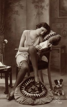 """Girl reading, 1920s. French postcard photograph. Photograph by Pisa, # 450.    """"Let us read and let us dance - two amusements that will never do any harm to the world."""" — Voltaire"""