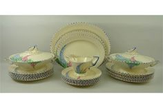 A Burleigh Ware Art Deco part tea set, Rd in cream ground with blue border and floral and
