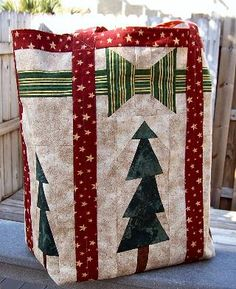 """Great Idea, Take a shopping bag and """"wrap"""" Christmas gifts in them, it is a gift that keeps giving and recycled throughout the year."""