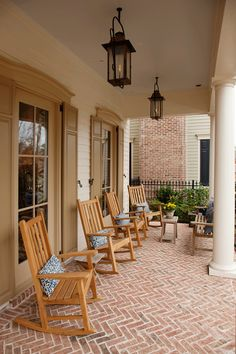 LOVE the feel of this porch - herringbone brick, the window trim detail and the shutters.