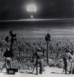Photographers record the blast from an air dropped atomic bomb at Yucca Flats, Nevada. March 31st 1953.
