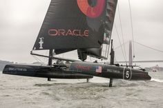 Oracle Team USA shows a hoisted L-dagger board, to windward, with the leeward hull fully supported and flying, while trialing in San Francisco on the AC45's