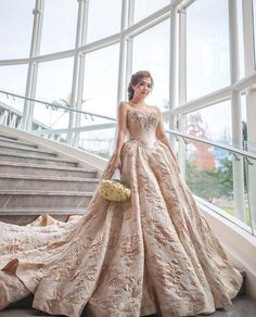 • everything you can imagine is real • wedding celebration of bride @millamonica 💕. looking very lovely in royal gold champagne ball gown . . #provocatebymeltatan #dress #ballgown #gold #champagne #fairytale #style #fashion #wedding #bride #bridebook #jakarta #rentgown #gelinlik #jacquard #gown #floral
