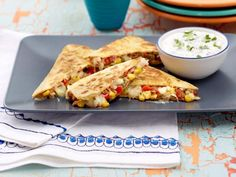 Southwest Quesadilla with Cilantro-Lime Sour Cream Recipe : Sunny Anderson : Food Network ~ I've made this and it's DELISH, however, I didn't care to much for the cilantro lime sour cream. Just my opinion Mexican Dishes, Mexican Food Recipes, Healthy Recipes, Cooking Recipes, Vegetarian Recipes, Avocado Recipes, Top Recipes, Vegetarian Cooking, Vegan Meals