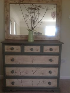 Chest of drawers and mirror painted with Annie Sloan chalk paint and hand painted cow parsley design.
