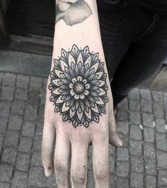 Impressive mandala flower tattoo on hand