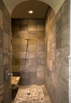 I like the natural stone tile and I LOVE the river-rock on the floor.... WANT!