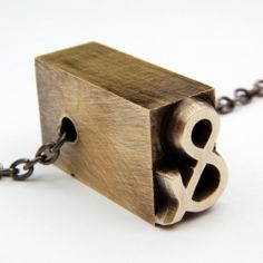 Tugging at our typography loving heart strings - vintage, repurposed jewelry by Gwen Delicious. Win a letterpress necklace!