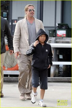 Brad Pitt takes his son Pax on a boat trip on June 10, 2013