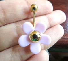 Very cute cherry blossom-esque daisy belly button ring. The bar is 14 gauge surgical steel and about 11mm long. Both ends unscrew and are acrylic