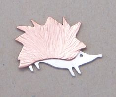 Hedgehog brooch in copper and sterling silver. Handcrafted and available from Jewellery By Silvana