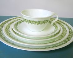 Spring Blossom Corelle by Corning-I have a total of 12 large dinner plates, 7 medium lunch plates, 12 small side plates, and 12 saucers (I've stopped collecting the open handle mugs-I have too many cups in this house!)