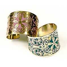 @Overstock - Handcrafted  in by Indian artisans, this cuff features an intricate floral motif carved into brass. With colorful fabric backing, this bracelet is a unique accessory that's as lovely as the artisans who created it.http://www.overstock.com/Worldstock-Fair-Trade/Blossom-Cuff-India/6385708/product.html?CID=214117 $19.99
