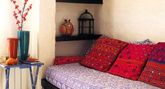 sari fabric is what I envision in my dream space, and a great little cozy nook..