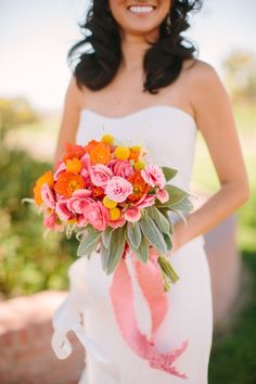 Peach and coral bridal bouquet with hanging peach ribbon #peachcoral #peachcoralwedding #bouquet #bride #flowers