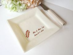 Wedding Cake Plate!  These unique cake plates are for people to use at wedding receptions. The bride and groom share and eat their first piece of wedding cake together with their own personalized plate!  The plate can then be kept and used as home decor or on the anniversary! #weddingplanning   #weddingdecor   #personalized   #bridalshowergift   #anniversary   #weddingreceptionideas   #weddingcaketabledecorations   #weddingcake