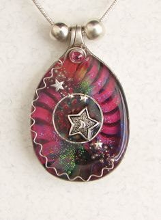 """wow ... If one tangible thing could represent who I am ... this is it! The stars, the colors, the non-shininess, simple (but only at first glance) ... truly this is me ...  I found at Fallon Shadowblade's site: """"Spoon Necklace Pendant featuring Pink Celestial Scene""""."""