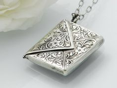 1902 Antique Sterling Silver Locket / Edwardian Silver Envelope / Love Token / Silver Stamp Case / Hallmarked Silver - 33 Inch Long Chain by ClosetGothic on Etsy https://www.etsy.com/listing/217369832/1902-antique-sterling-silver-locket