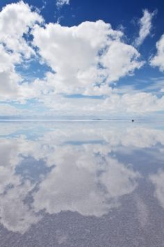 The Salar de Uyuni in Bolivia is the worlds largest salt flat. The salt is over 10 meters thick in the center. In the dry season, the salt planes are a completely flat expanse of dry salt, but in the wet season, it is covered with a thin sheet of water that is still drivable.