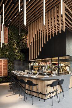 Kimmel Eshkolot uses wooden curtains to separate areas in restaurant in Tel Aviv - Archlovin' Bg Design, Bar Interior Design, Restaurant Interior Design, Cafe Design, Open Kitchen Restaurant, Deco Restaurant, Modern Restaurant, Bar Bistro, Café Bar