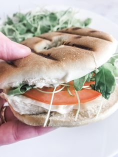 Creamy basil pesto mayo is spread on a bagel thin and topped with grilled chicken cheese tomato and arugula and grilled into a Pesto Mayo Chicken Panini! Chicken Panini, Mayo Chicken, Grilled Chicken, Bagel Thins, Sandwich Thins, Panini Sandwiches, Pesto Mayo, Basil Pesto, Ww Recipes