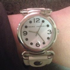 Marc by Marc Jacobs watch USED. White Marc Jacobs watch with a little wear around the band.  Not noticeable when the watch is worn. (See first photo). Stainless steel. Marc by Marc Jacobs Jewelry