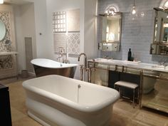 Waterworks white Empire tub with new Henry freestanding tub filler (front), new Henry double vanity with Keystone Zephyr marble slab, new Henry medicine cabinets, Grove Brickworks wall tile in Dirty Silver, Candide freestanding tub with Olypia tub filler (back).